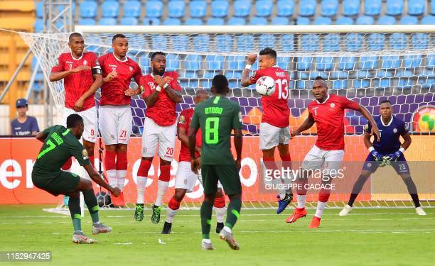 Nigeria's forward Ahmed Musa hits a free kick during the 2019 Africa Cup of Nations Group B football match between Madagascar and Nigeria at the...