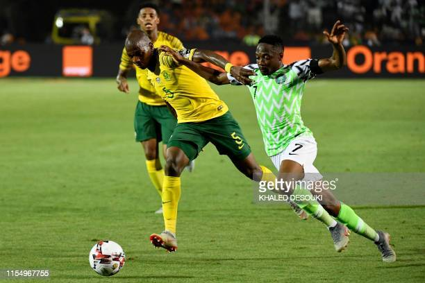Nigeria's forward Ahmed Musa is marked by South Africa's defender Thamsanqa Mkhize during the 2019 Africa Cup of Nations quarter final football match...