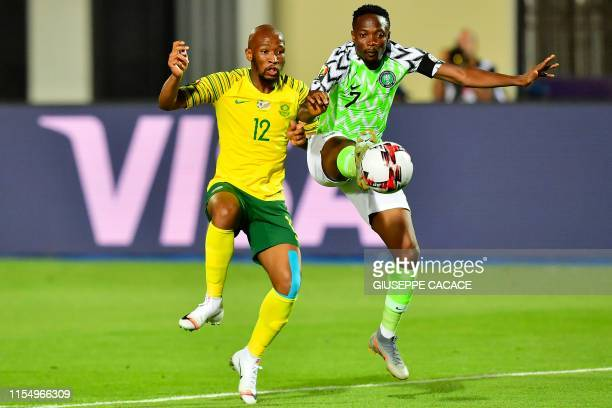 Nigeria's forward Ahmed Musa is marked by South Africa's midfielder Kamohelo Mokotjo during the 2019 Africa Cup of Nations quarter final football...