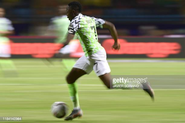 Nigeria's forward Ahmed Musa runs with the ball during the 2019 Africa Cup of Nations Round of 16 football match between Nigeria and Cameroon at the...