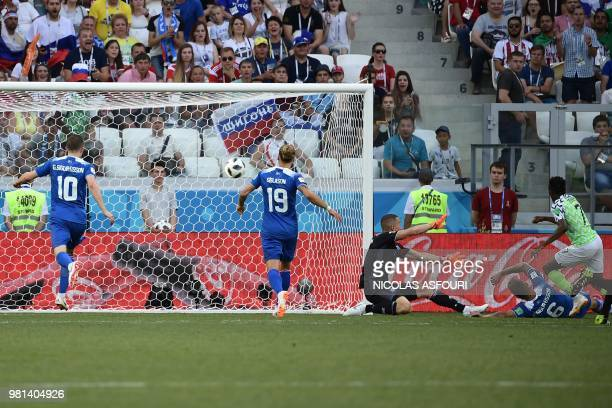 Nigeria's forward Ahmed Musa score their opener during the Russia 2018 World Cup Group D football match between Nigeria and Iceland at the Volgograd...