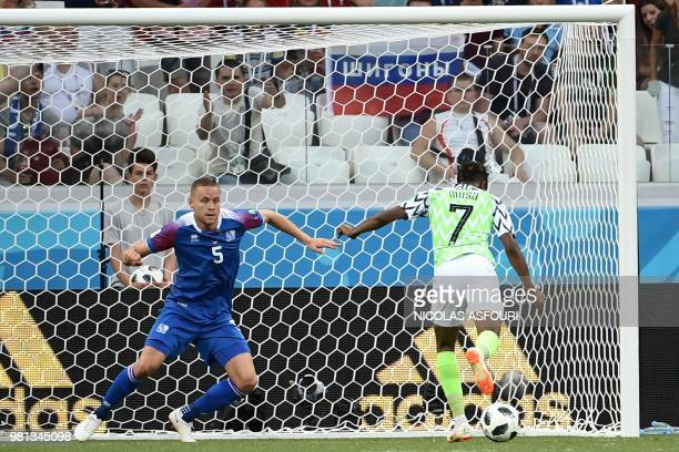 Nigeria's forward Ahmed Musa scores their second goal past Iceland's defender Sverrir Ingason during the Russia 2018 World Cup Group D football match...