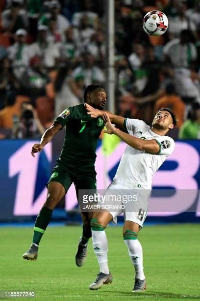 Nigeria's forward Ahmed Musa vies for the ball with Algeria's forward Youcef Belaili during the 2019 Africa Cup of Nations Semi-final football match...