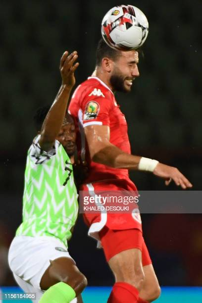 Nigeria's forward Ahmed Musa vies for the ball with Tunisia's midfielder Ghaylen Chaalali during the 2019 Africa Cup of Nations third place play-off...