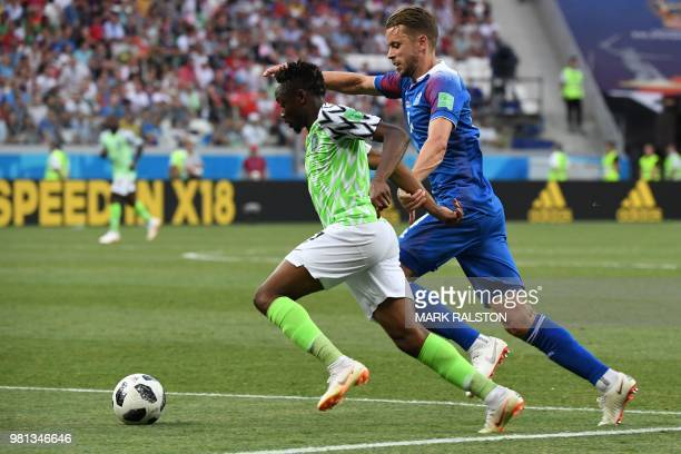 Nigeria's forward Ahmed Musa vies with Iceland's defender Kari Arnason during the Russia 2018 World Cup Group D football match between Nigeria and...
