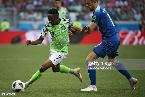 Nigeria's forward Ahmed Musa vies with Iceland's midfielder Gylfi Sigurdsson during the Russia 2018 World Cup Group D football match between Nigeria...