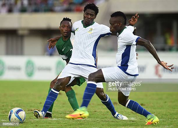 Nigeria's forward Ahmed Musa vies with Tanzania's players during the 2017 African Cup of Nations qualification football match between Nigeria and...