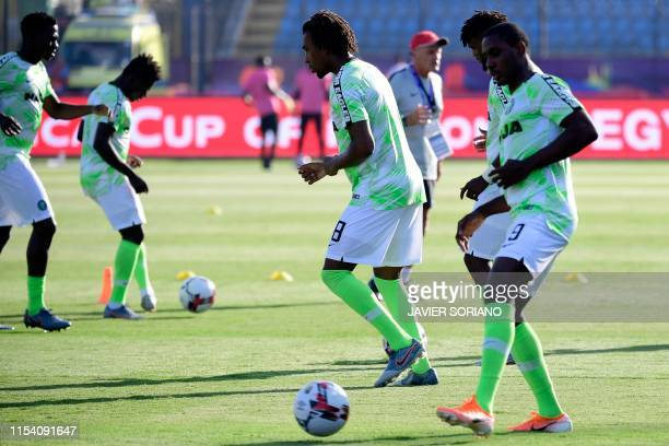 Nigeria's forward Alex Iwobi and Nigeria's forward Odion Ighalo warm up ahead the 2019 Africa Cup of Nations Round of 16 football match between...