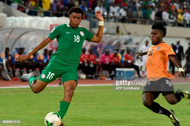 Nigeria's forward Alex Iwobi fights for the ball with Zambia's midfielder Simon Silwimba during the FIFA World Cup 2018 qualifying football match...