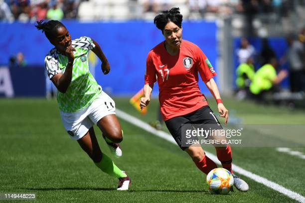 Nigeria's forward Chinaza Uchendu vies for the ball with South Korea's forward Lee Geummin during the France 2019 Women's World Cup Group A football...