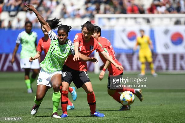 Nigeria's forward Chinaza Uchendu vies for the ball with South Korea's defender Jang Selgi during the France 2019 Women's World Cup Group A football...