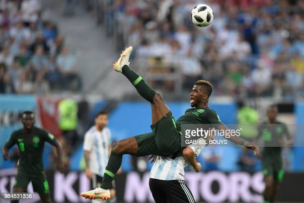 TOPSHOT Nigeria's forward Kelechi Iheanacho and Argentina's midfielder Javier Mascherano compete for the ball during the Russia 2018 World Cup Group...