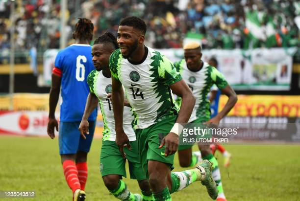 Nigeria's forward Kelechi Iheanacho celebrates with teammates after scoring a goal during the FIFA Qatar 2022 World Cup qualification football match...