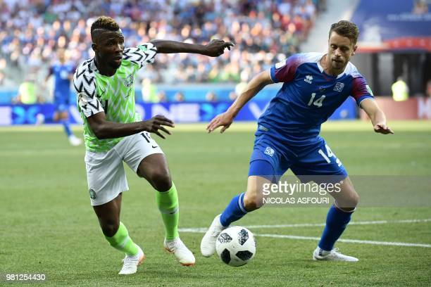 Nigeria's forward Kelechi Iheanacho vies with Iceland's defender Kari Arnason during the Russia 2018 World Cup Group D football match between Nigeria...