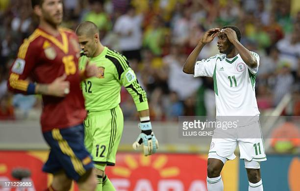 Nigeria's forward Muhammad Gambo gestures after missing a goal opportunity against Spain during their FIFA Confederations Cup Brazil 2013 Group B...