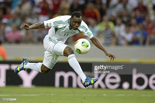 Nigeria's forward Muhammad Gambo tries to score against Spain during their FIFA Confederations Cup Brazil 2013 Group B football match at the Castelao...