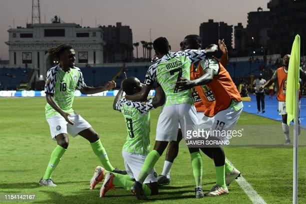 Nigeria's forward Odion Ighalo celebrates his second goal with teammates during the 2019 Africa Cup of Nations Round of 16 football match between...
