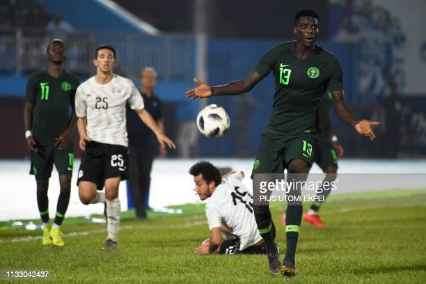 Nigeria's forward Paul Onuachu reacts to the referee during a friendly football match between Nigeria and Egypt at Stephen Keshi Stadium in the Asaba...