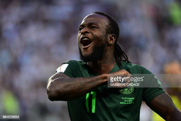 TOPSHOT Nigeria's forward Victor Moses celebrates scoring a penalty to equalise during the Russia 2018 World Cup Group D football match between...