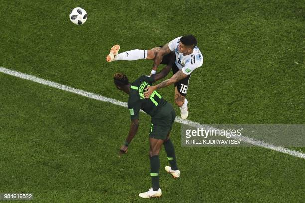 Nigeria's goalkeeper Daniel Akpeyi and Argentina's defender Marcos Rojo compete for the ball during the Russia 2018 World Cup Group D football match...