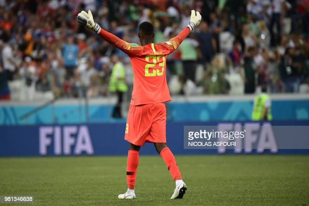 Nigeria's goalkeeper Francis Uzoho celebrates their victory at the end of during the Russia 2018 World Cup Group D football match between Nigeria and...