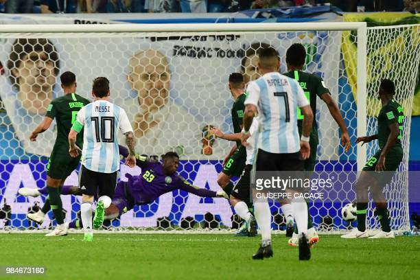 Nigeria's goalkeeper Francis Uzoho concedes a goal during the Russia 2018 World Cup Group D football match between Nigeria and Argentina at the Saint...