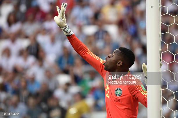 Nigeria's goalkeeper Francis Uzoho gestures during the Russia 2018 World Cup Group D football match between Nigeria and Iceland at the Volgograd...