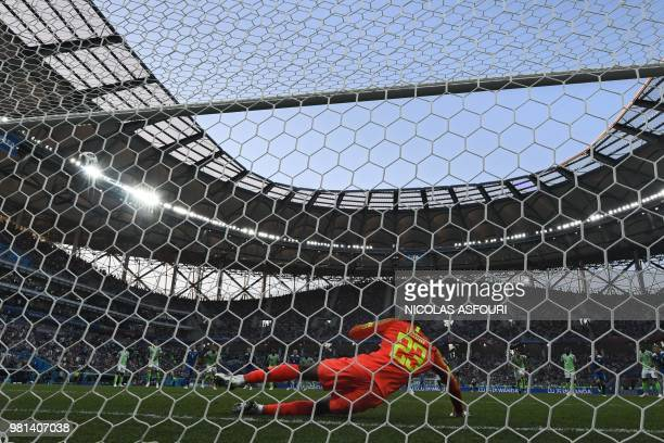Nigeria's goalkeeper Francis Uzoho saves a goal on a penalty shot during the Russia 2018 World Cup Group D football match between Nigeria and Iceland...