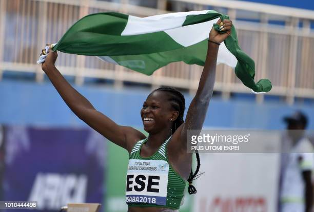 Nigeria's gold medalist in the Women's long jump event Ese Brume celebrates with the national flag during the 21st African Senior Athletics...