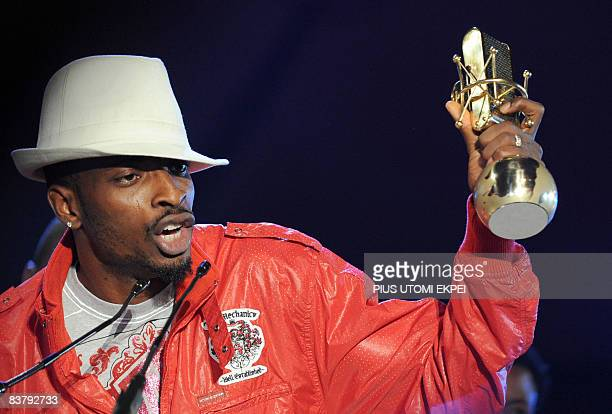 Nigeria's hiphop artiste 9ice speaks after collecting his award during the MTV Awards ceremony at the Veldrome in Abuja on November 22 2008 The first...