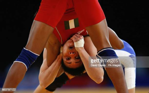 Nigeria's Ifeoma Nwoye is held by Canada's Brittanee Laverdure during the Women's Wrestling at the SECC during the 2014 Commonwealth Games in Glasgow