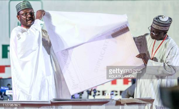 Nigeria's Independent National Electoral Commission chairman Mahmood Yakubu displays vote result sheets on February 25 2019 in Abuja during the...