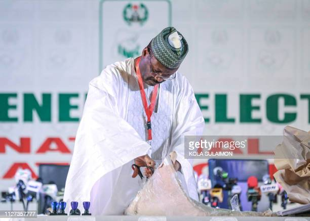 Nigeria's Independent National Electoral Commission chairman Mahmood Yakubu opens a unveils result cheets on February 25 2019 in Abuja during the...
