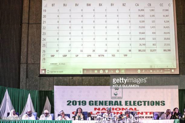 Nigeria's Independent National Electoral Commission members attend the presidential elections announcement on February 25 2019 in Abuja Muhammadu...