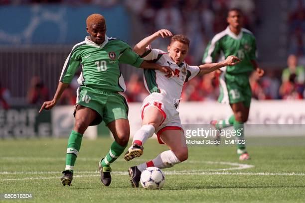 Nigeria's JayJay Okocha and Bulgaria's Ilian Iliev battle for the ball