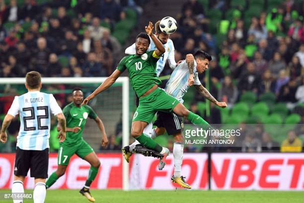 Nigeria's John Obi Mikel Argentina's German Pezzella and Argentina's Enzo Perez vie for the ball during an international friendly football match...