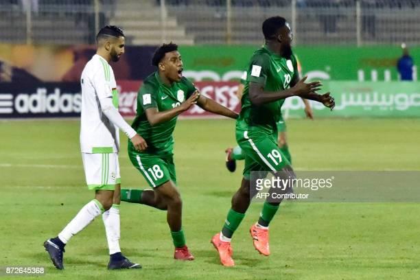 Nigeria's John Ogu celebrates with Nigeria's Alexander Iwobi after scoring a goal during the 2018 FIFA World Cup Group B qualifying football match...