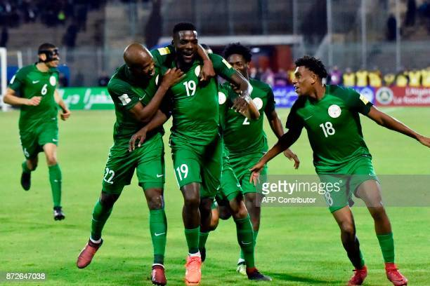 Nigeria's John Ogu celebrates with teammates after scoring a goal during the 2018 FIFA World Cup Group B qualifying football match between Algeria...