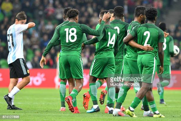 Nigeria's Kelechi Iheanacho celebrates with teammates after scoring the team's first goal during an international friendly football match between...