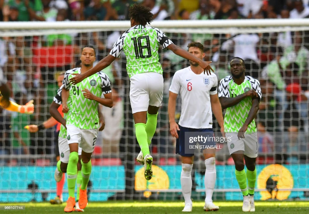 Nigeria's midfielder Alex Iwobi (C) celebrates after scoring their first goal during the International friendly football match between England and Nigeria at Wembley stadium in London on June 2, 2018.