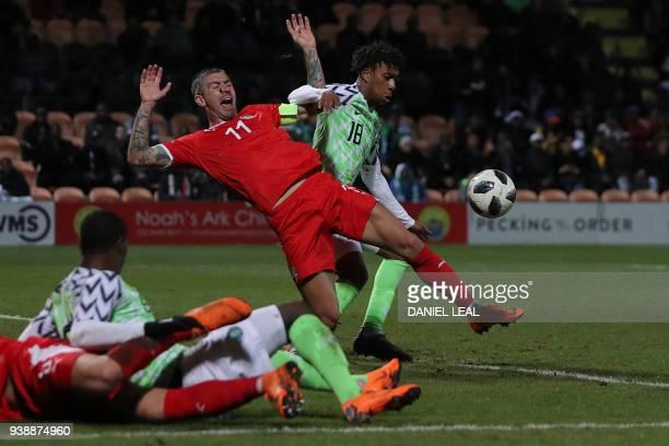 Nigeria's midfielder Alex Iwobi clashes with Serbia's defender Aleksandar Kolarov during the International friendly football match between Nigeria...