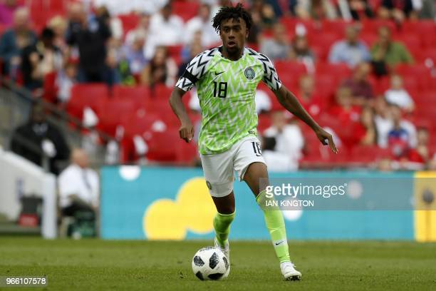 Nigeria's midfielder Alex Iwobi runs with the ball during the International friendly football match between England and Nigeria at Wembley stadium in...