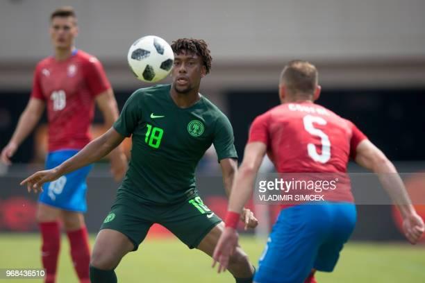 Nigeria's midfielder Alex Iwobi vie for a ball with Vladimir Coufal of Czech Republic during the international friendly football match between...