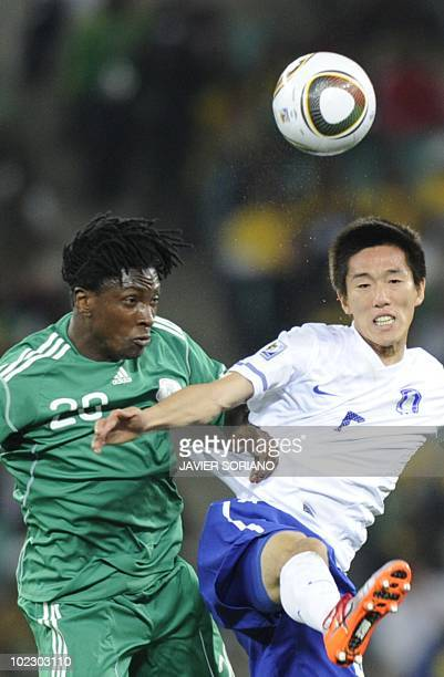 Nigeria's midfielder Dickson Etuhu clashes with South Korea's midfielder Kim JungWoo during the Group B first round 2010 World Cup football match...