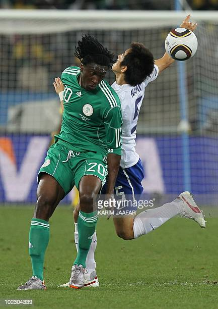 Nigeria's midfielder Dickson Etuhu vies with South Korea's midfielder Kim NamIl during their Group B first round 2010 World Cup football match on...