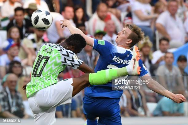 TOPSHOT Nigeria's midfielder John Obi Mikel vies with Iceland's forward Jon Bodvarsson during the Russia 2018 World Cup Group D football match...