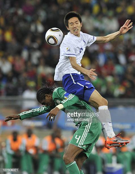 Nigeria's midfielder Nwankwo Kanu clashes with South Korea's midfielder Kim JungWoo during the Group B first round 2010 World Cup football match...