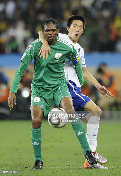Nigeria's midfielder Nwankwo Kanu fights off South Korea's midfielder Kim JungWoo during the Group B first round 2010 World Cup football match...