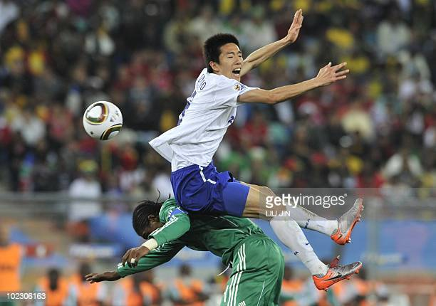 Nigeria's midfielder Nwankwo Kanu vies with South Korea's midfielder Kim JungWoo during their Group B first round 2010 World Cup football match on...