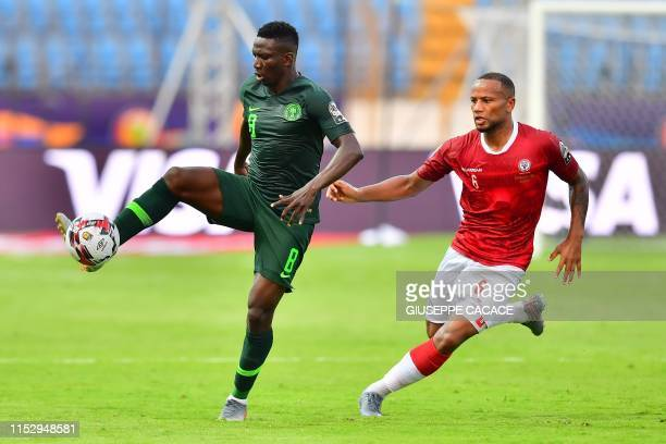 Nigeria's midfielder Oghenekaro Etebo vies for the ball with Madagascar's midfielder Marco Ilaimaharitra during the 2019 Africa Cup of Nations Group...